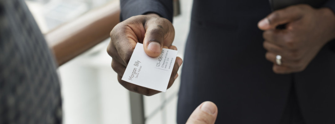man giving his address card