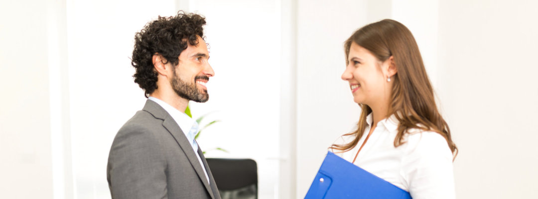 man and woman talking to each other